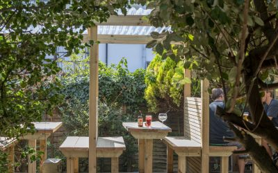 Alfresco seating in the beer garden with plants and foliage