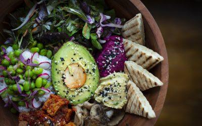 A colourful buddha bowl with avocado, greens and tofu