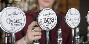 Beer taps with handwritten labels for Larrikin ales and stout