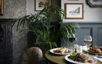 Interiors shot at The Walrus with a table of roast dinners served with wine