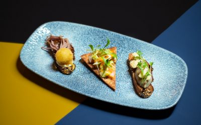 Selection of three pincho: confit duck, truffle honey and goat cheese croqueta. Marinated salmon belly and avocado with a spicy Sriracha mayonnaise, nacho and Smoked aubergine moutabal and Stilton