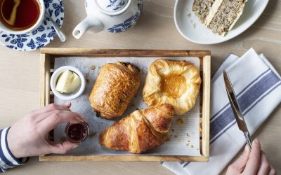 Breakfast pastries served with a pot of tea