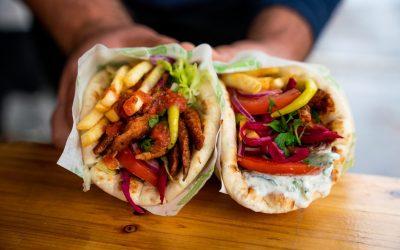 Two vegan flatbread kebabs with vegan donna