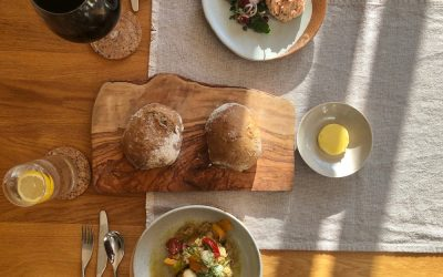 Rustic bowls of starters with Smoked Trout Rillette and Tomatoes with Baba Ghanoush, served alongside sourdough rolls.