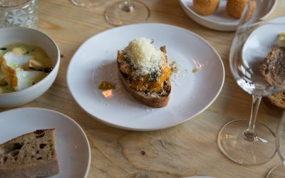 A selection of small plates including arancini balls, bruschetta and rustic bread