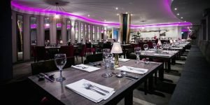 Interior shot of the restaurant with a monochrome theme and colourful lights