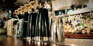 A close photograph of the bar with cocktail mixing glasses