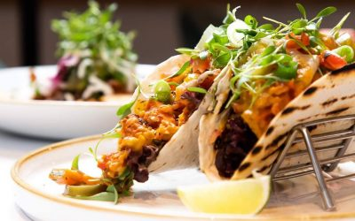Vegan tacos with microgreens and a wedge of lime