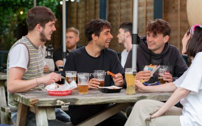 group of people enjoying beer in pubs garden