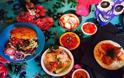 Colourful Mexican dishes with tacos, rice burrito bowls and vegetable sides.