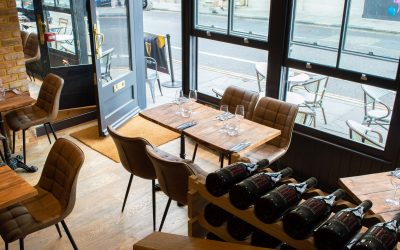 luxurious chairs and tables places next to the big windows showing the view of the Church Street