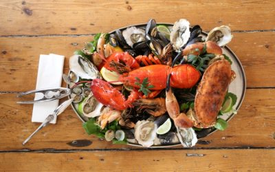 Lobster platter at the Copper Clam served on an oval tray with oysters, clams and musssels.