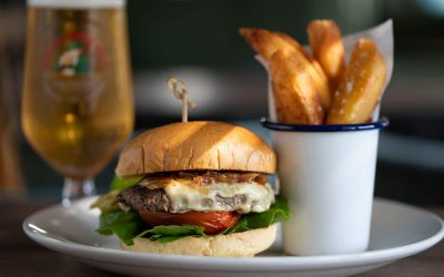 burger with chips and glass of beer